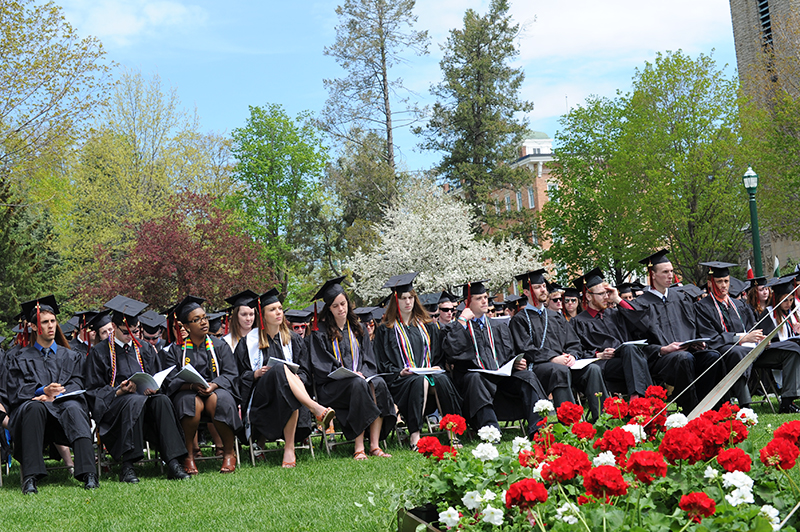 St. Lawrence Graduates seated outdoors